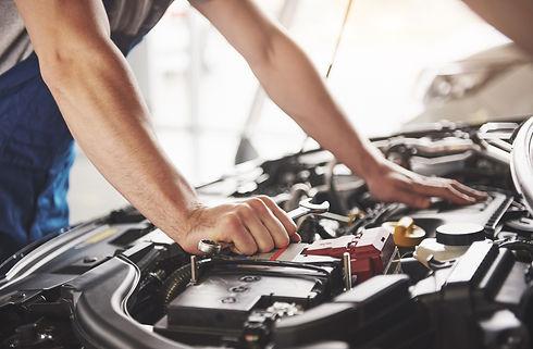 auto-mechanic-working-in-garage-repair-service.jpg