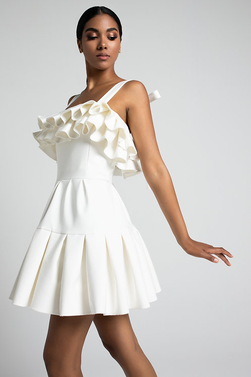 Short white dress with playful ruffed detail