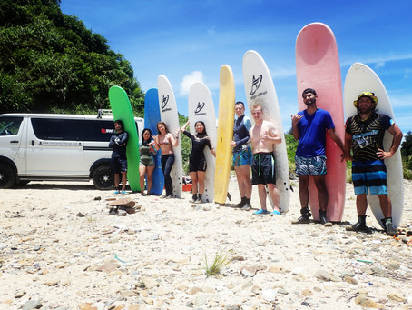 Learn surfing in okinawa . Tropical surf house watersport surf school , snorkeling tour , kitesurf