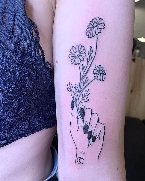 Custom witchy hand holding daisies and b