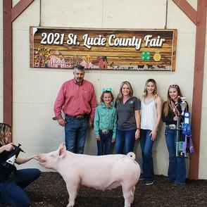 Kaleighan Chancey St. Lucie County Fair  Grand Champion Market Swine