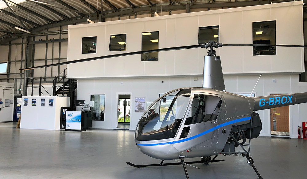 R22 helicopter in front of classrooms