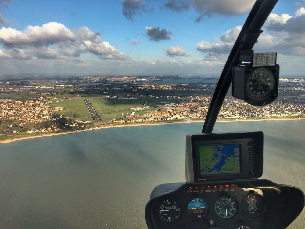 Birds eye view of helicopter approaching Solent Airport.