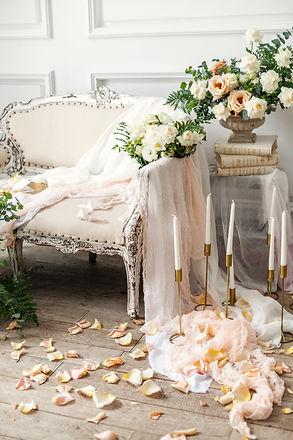 Wedding arrangement with a white chair,