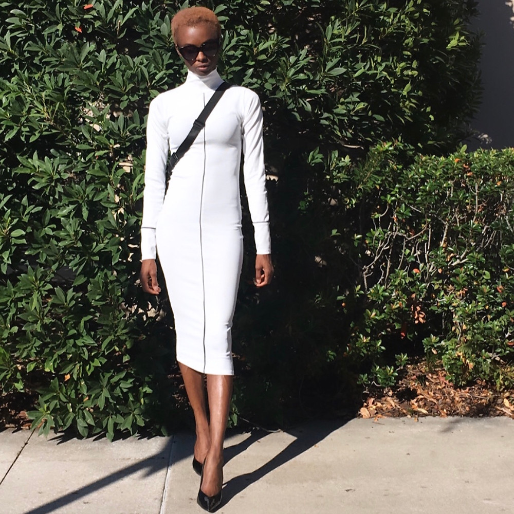 White, long sleeve, High neck, bodycon, Midi Dress  https://femmeluxefinery.com/collections/high-neck-bodycon-dresses  Bumbag: https://femmeluxefinery.co.uk/products/black-gold-zip-bum-bag-eden
