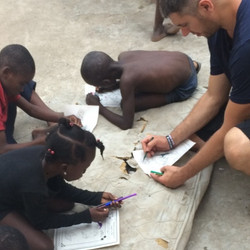 Coloring on the orphanage roof top.