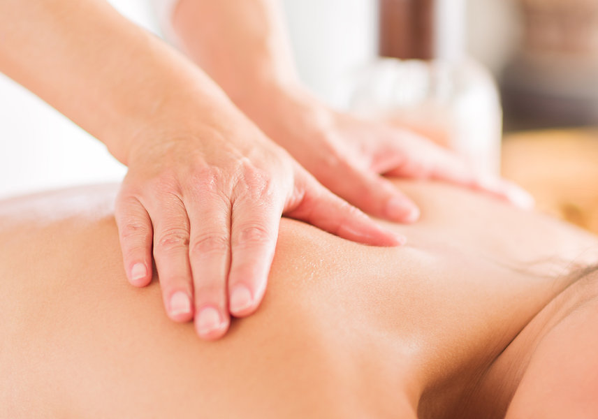 Attractive Woman Having A Massage With M