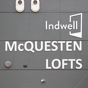 Mid shot of the Indwell Mcquesten Lofts signage.