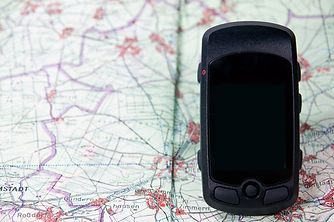 handheld gps on a route map.jpg