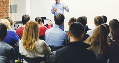 Adult students listen to professor's lec