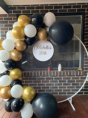 Black, White and Gold Balloon Garland and Mesh Wall
