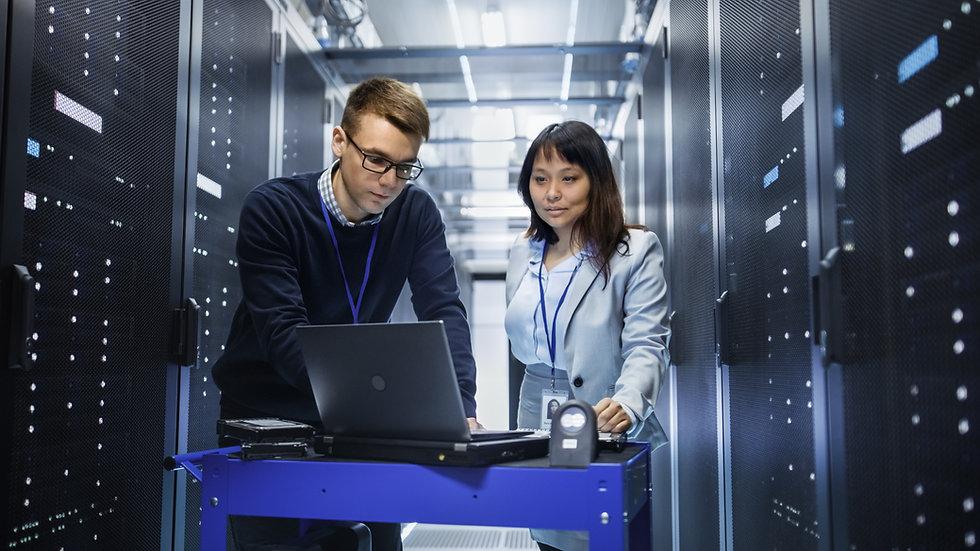 Caucasian Male and Asian Female IT Techn