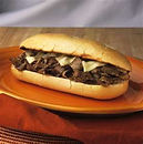our delicious Philly's comes with Sauteed Mushrooms, and Sauteed Onions, smothered with Melted Provolone Cheese, served with Fries or Home made Cole Slaw