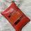 Thumbnail: Pochette rouge avec bande