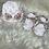 Thumbnail: Bonnet et chaussons de naissance rose