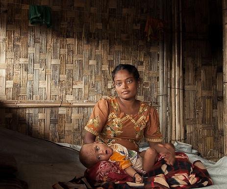 Women from Rohingya holding her baby