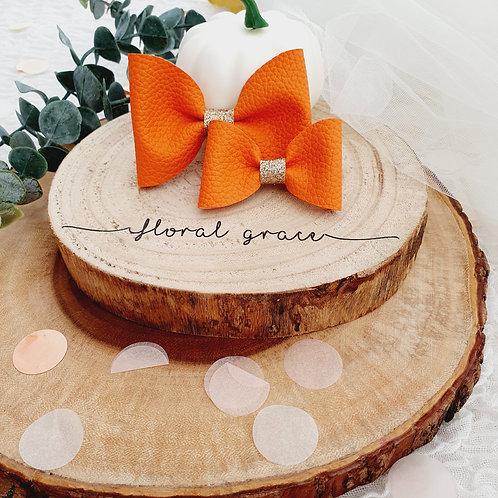 Orange leatherette bow