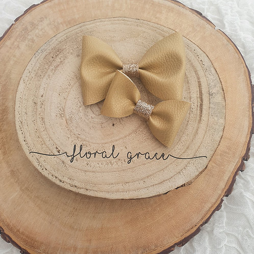 Gold leatherette bow