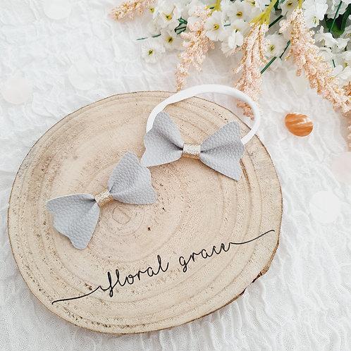 Grey leatherette flutter bow