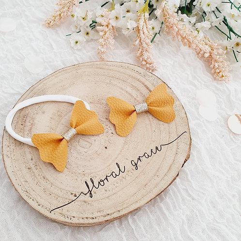 Mustard leatherette flutter bow
