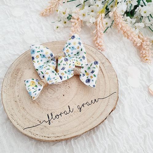 Blue floral leatherette bow