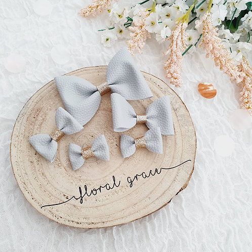 Grey Leatherette Bow