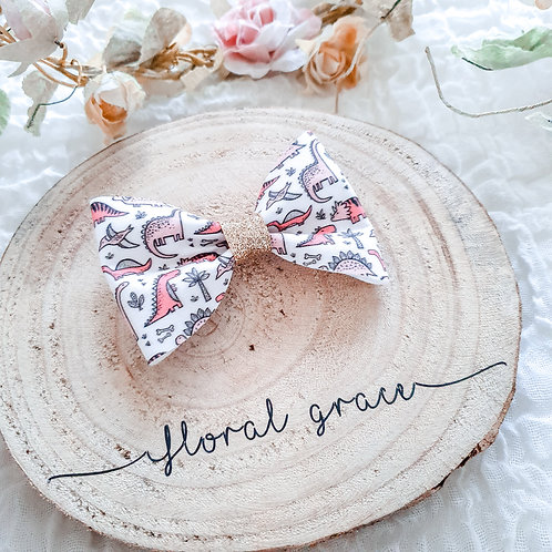 Pink dinosaurs bow