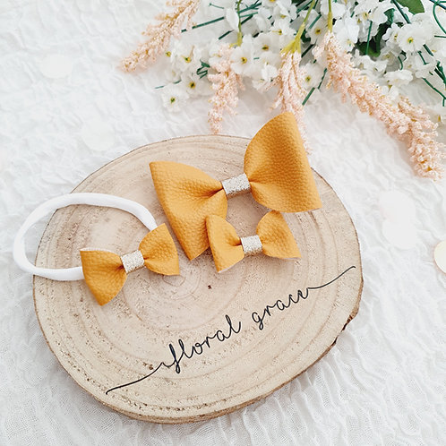 Mustard leatherette bow