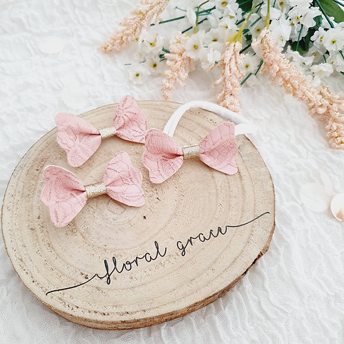 Pink lace flutter bow