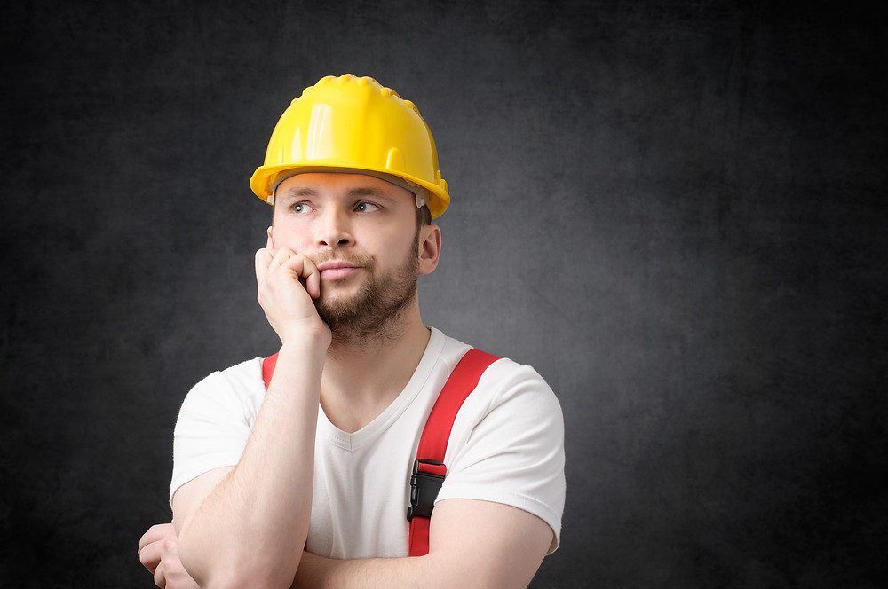 Bored and indifferent construction worker