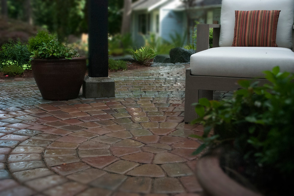 Landscape with paving stone patio featuring villa stone circle kit.