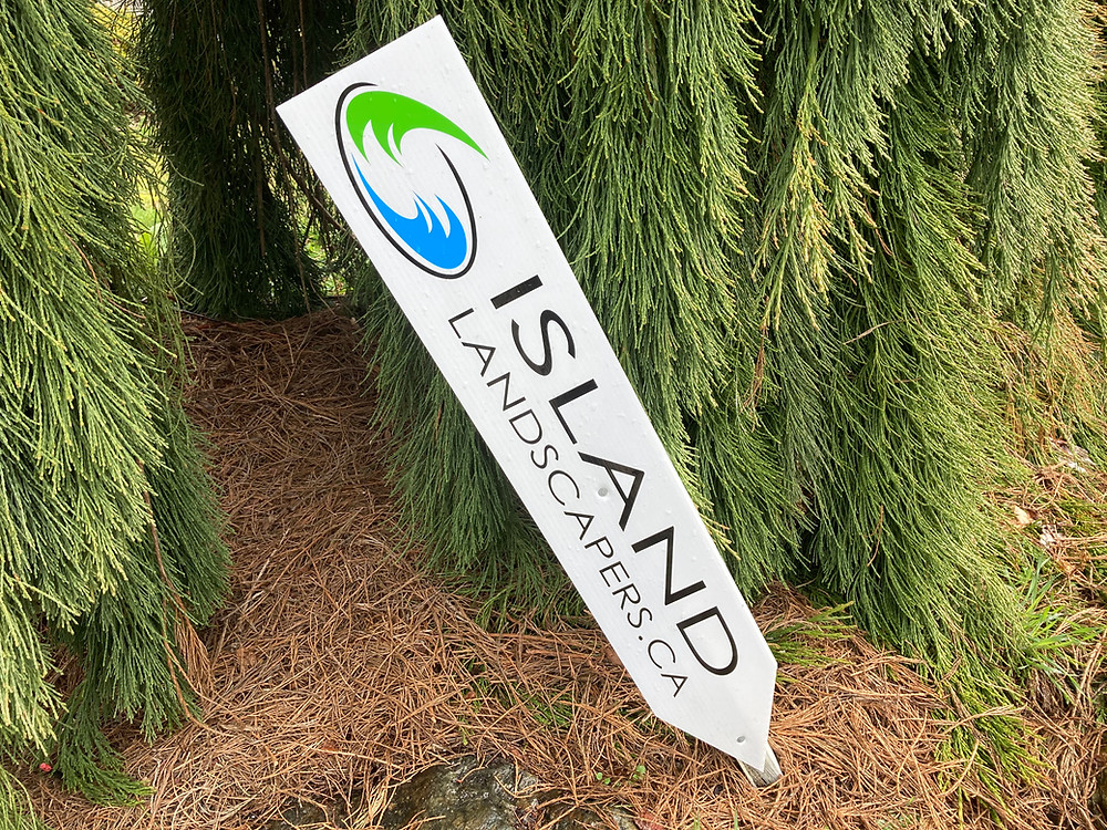Island Landscapers Inc. sign in white with logo and website.