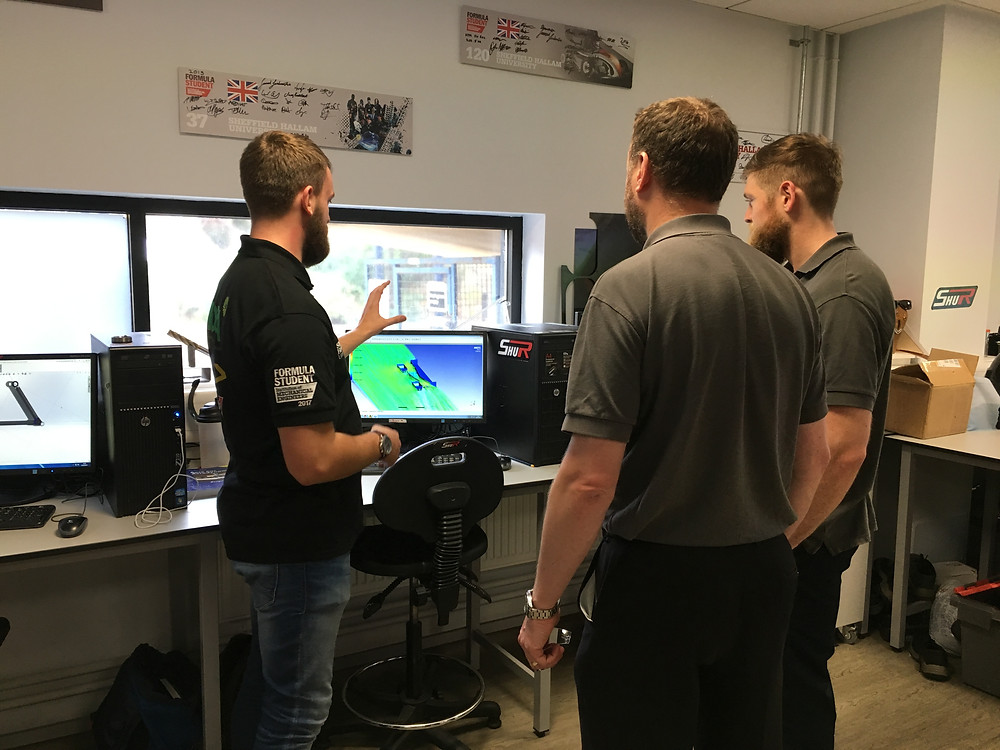 SHU Racing explain chassis evolution and development to the team from IIDEA