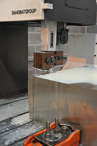 Precision sawing of a large block of 300 series stainless steel prior to further machining operations at IIDEA Limited, Sheffield