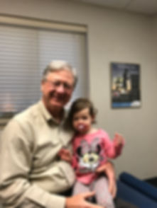 Dr. Gloekler and his granddaughter