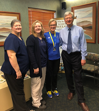 Dr. Gloekler with some of his staff and a patient he prepared for Boston Marathon