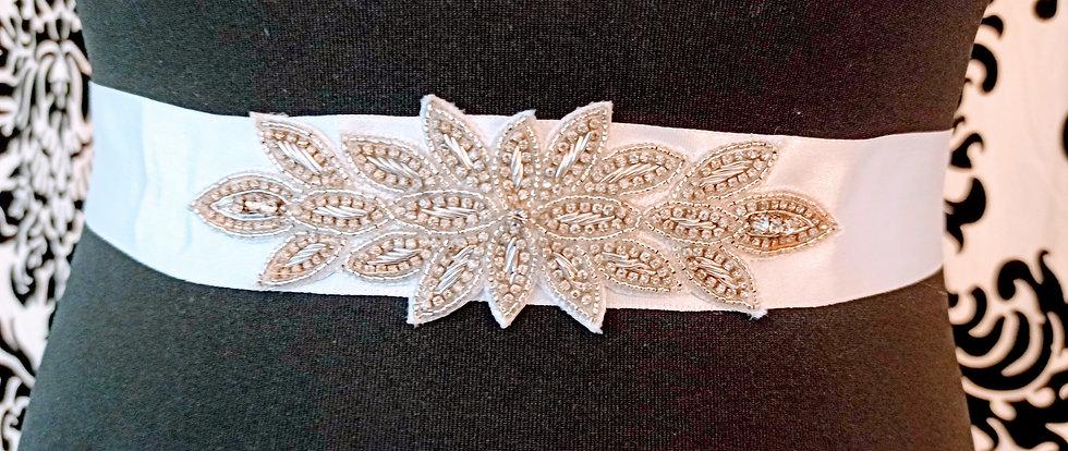 Diamante applique on white satin sash