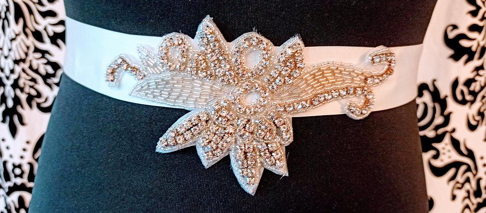 Diamante flower on ivory satin sash