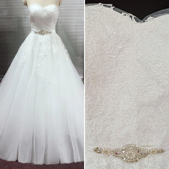 Can be ordered in size 8 to 16, ivory lace and tulle wedding dress