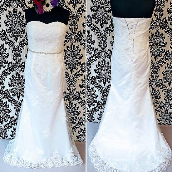 Can be ordered in size 8 - 18, ivory lace fit & flare lace-up back wedding dress