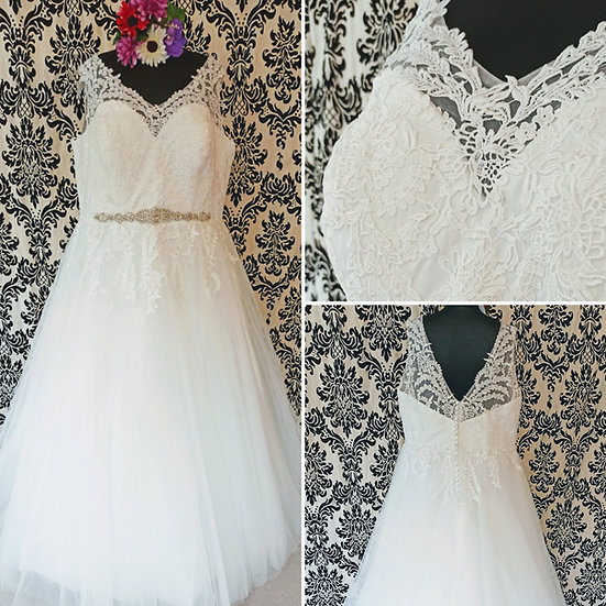 Can be ordered in 8 - 16, ivory lace & tulle wedding dress with straps