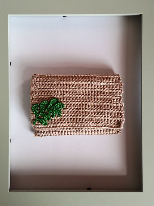 soft crocheted teak purse with green leaves and green lining