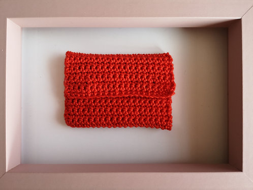 tiny red crocheted purse