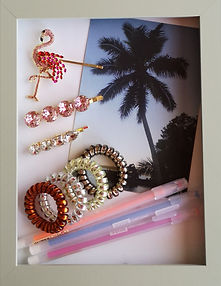 Flamingo and sparkly pink and white hairgrips. An exotic postcard, colourful pens and stretchy spiral cord hairbands