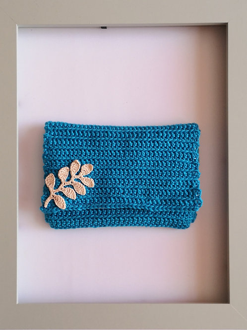 soft crocheted blue purse with light leaves