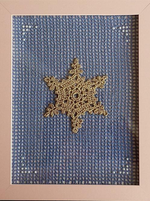 framed gold snowflake on blue filet mesh
