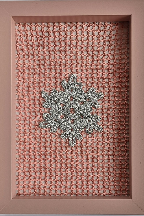 framed silver snowflake on pink filet mesh