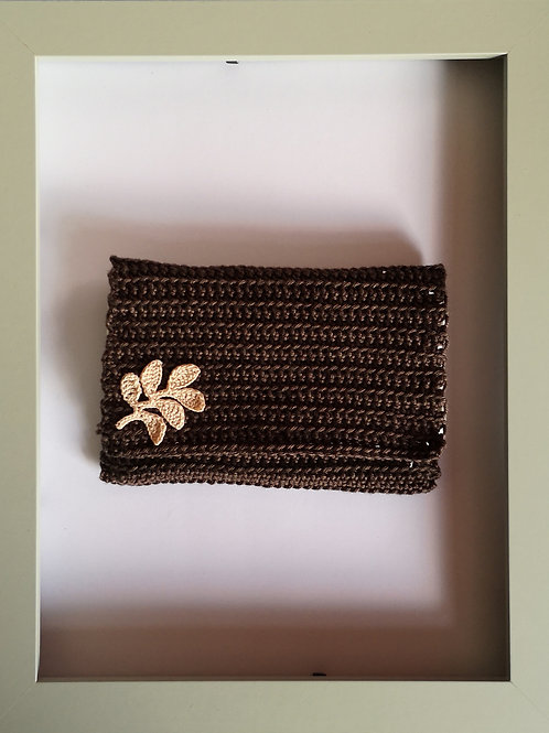 soft crocheted dark brown purse with light leaves and ivory lining