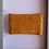 Thumbnail: soft crocheted mustard yellow purse with light leaves