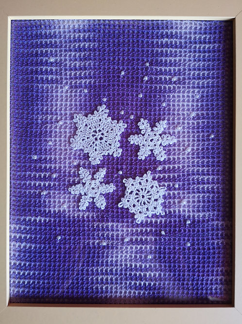 framed white snowflakes and beads on purple and white filet mesh